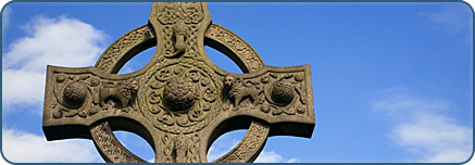 Stone Celtic cross against blue sky